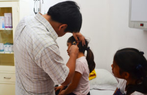 Girl having her ears checked at the clinic