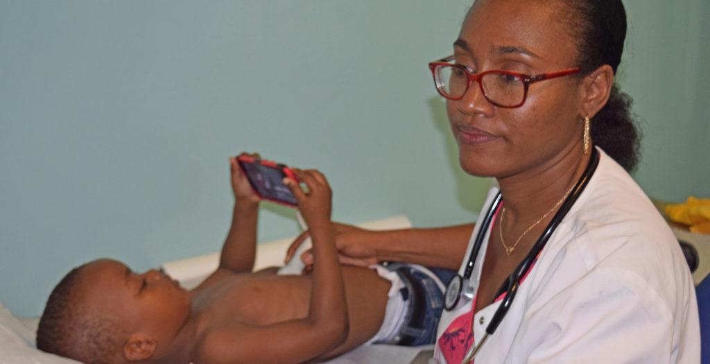 Dr Noisette examining a patient
