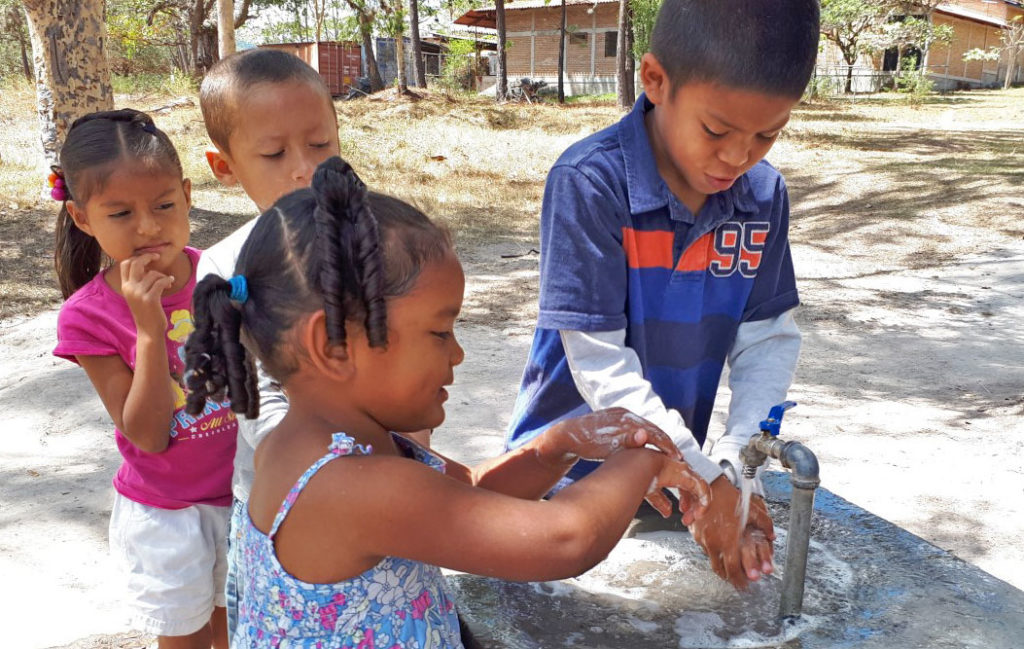Children washing hands at NPH Honduras