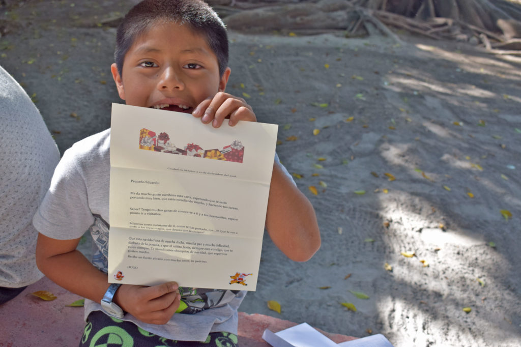 Mexican boy showing letter