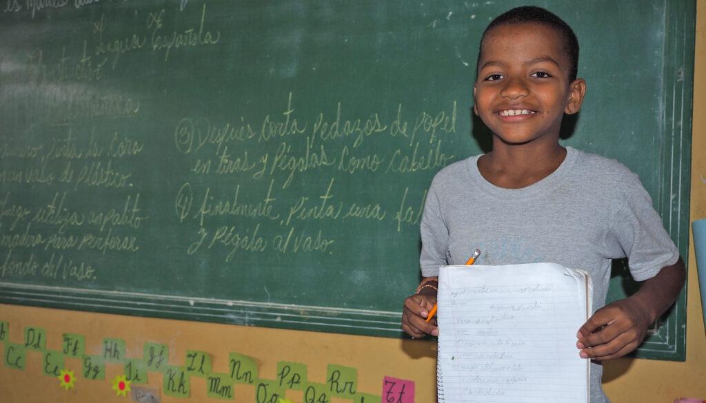 Hernando showing off his school work